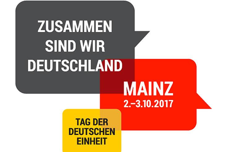 Das Logo ist unterteilt in drei Sprechblasen, in den Farben der deustche Flagge, und bedruckt mit den Rahmendaten des Tages der Deutschen Einheit.