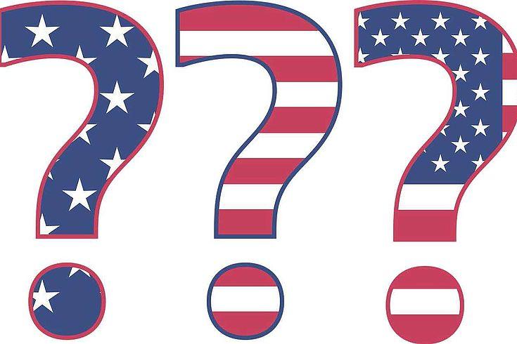 Drei Fragezeichen mit USA Flagge darauf